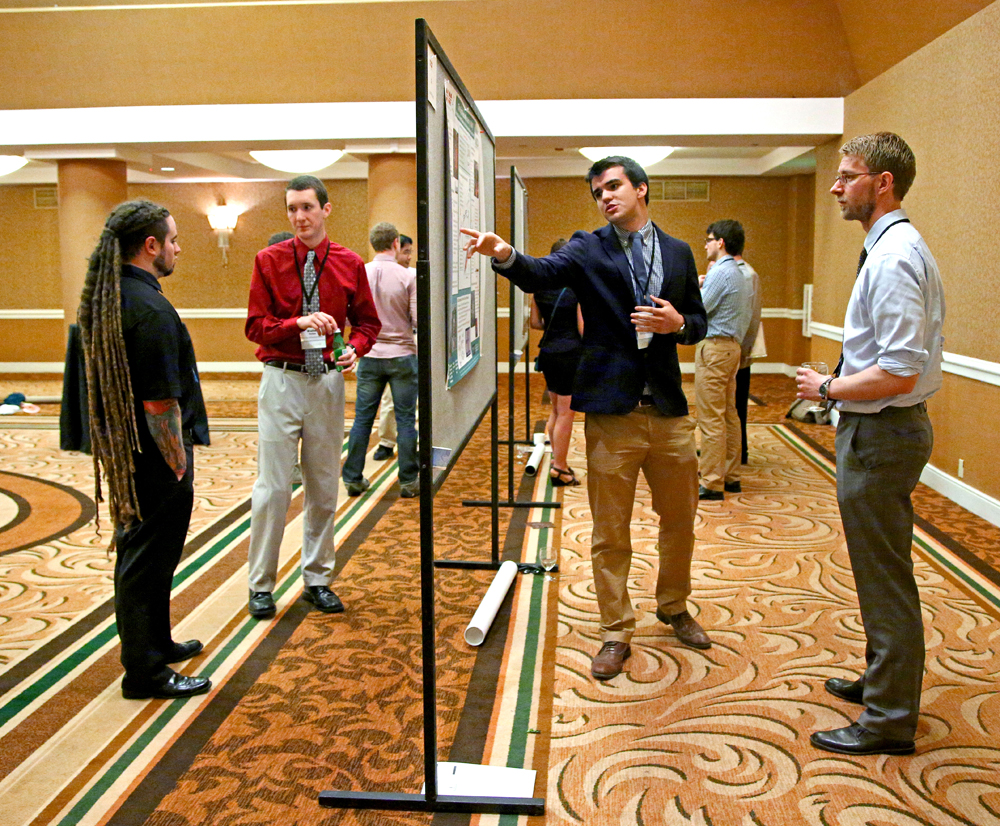 Fellows present their research at the annual poster session.